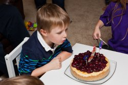 Andrew blows out his candles