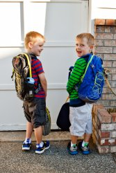 Will and Andrew show off their backpacks