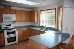 Kitchen with corian counters and cool double oven