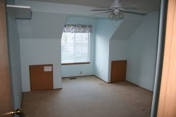 "Bedroom 2 -- Note the pokemon curtain and ""Keep Out -- Boy's Clubhouse"" sign"