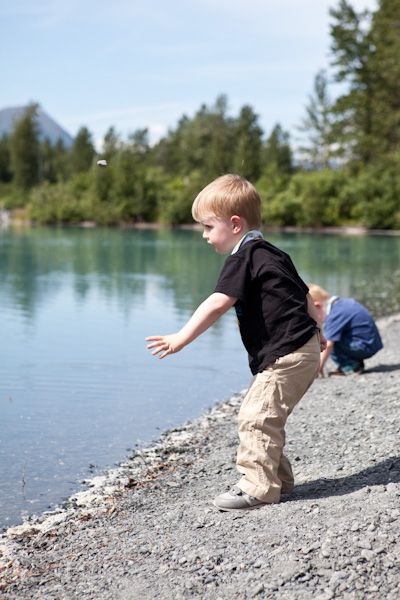 Will throws a rock in the lake