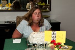 Bekki blows out the baked alaska cake
