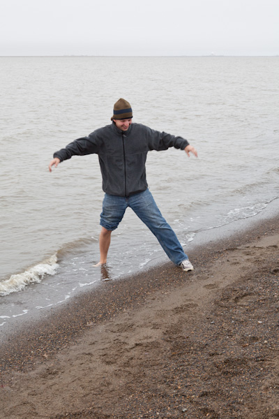 Dude on our tour dips his foot into the Arctic Ocean