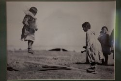This photo of Inuit children playing on a makeshift seesaw really struck me.