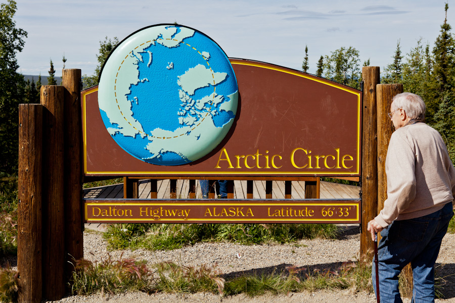 Norm in front of the Arctic Circle sign