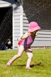 Kate in the sprinkler 1