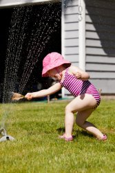 Kate in the sprinkler 2