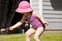 Kate in the sprinkler 3