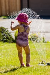Kate in the sprinkler 8
