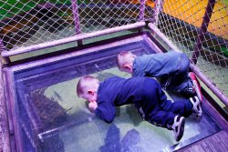 Andrew and Will lay on the glass floor looking at rays
