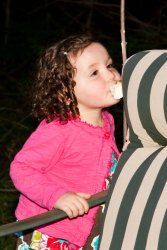 Violet sneakily eating a marshmallow off a stick 1