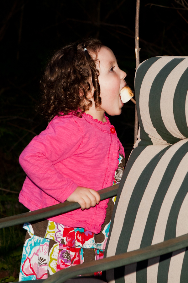 Violet sneakily eating a marshmallow off a stick 2