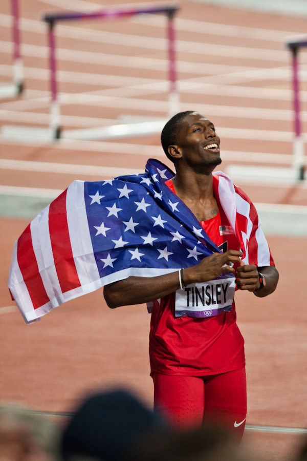 American Michael Tinsley celebrates his silver medal in the Men's 400m Hurdles 2