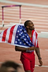 American Michael Tinsley celebrates his silver medal in the Men's 400m Hurdles 3