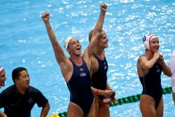 Lauren Wenger, Betsey Armstrong and Kelly Rulon celebrate gold