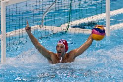 Croatia's goalie Josip Pavic celebrates gold
